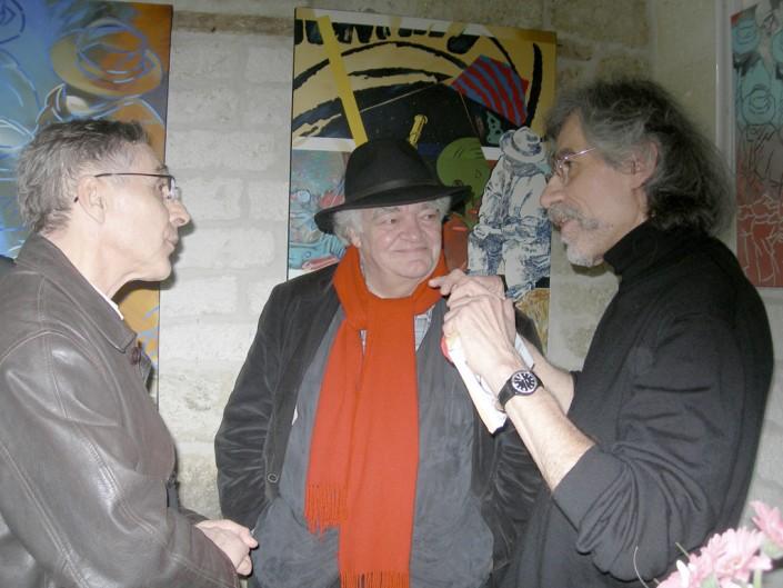 Daniel Aoudia, rédacteur-concepteur, à gauche, converse avec Vautrin et Henri Talvat au centre